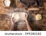 male hand preparing pizza dough ... | Shutterstock . vector #599280182