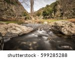 mountain stream cascading... | Shutterstock . vector #599285288