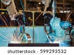 team robot welding are test run ...   Shutterstock . vector #599293532