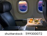 tray of food on the airplane ... | Shutterstock . vector #599300072