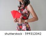 asian girl with cheongsam show...   Shutterstock . vector #599312042