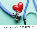 stethoscope and heart on blue... | Shutterstock . vector #599327216