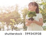 kid holding young plant in... | Shutterstock . vector #599343938