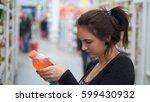 woman buys juice in supermarket ... | Shutterstock . vector #599430932
