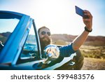 bearded guy in vintage car... | Shutterstock . vector #599483576