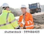 happy engineer discussing with... | Shutterstock . vector #599486405