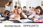professor and elementary age... | Shutterstock . vector #599510972
