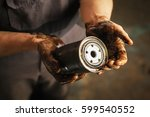 auto mechanic with dirty hands... | Shutterstock . vector #599540552