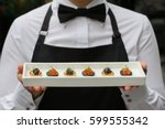 Small photo of waiter with canapes / canapes with caviar / catering