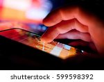 a person using a portable... | Shutterstock . vector #599598392