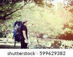 traveler man with backpack... | Shutterstock . vector #599629382