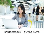 businesswoman working on... | Shutterstock . vector #599654696