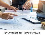 architects engineer discussing... | Shutterstock . vector #599699636