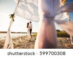 honeymooners couple embracing... | Shutterstock . vector #599700308