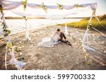 young couple in love sitting on ... | Shutterstock . vector #599700332