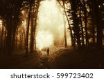 man in fantasy forest walking... | Shutterstock . vector #599723402