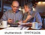 an elderly couple uses... | Shutterstock . vector #599741636