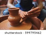 potter using hand tool for... | Shutterstock . vector #599795462