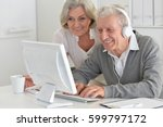 elderly couple with a laptop | Shutterstock . vector #599797172