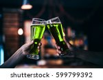 two friends toasting with... | Shutterstock . vector #599799392