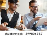 financial managers discussing... | Shutterstock . vector #599806952
