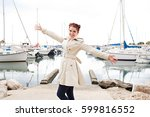 joyful young woman playful with ... | Shutterstock . vector #599816552