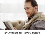thoughtful man missing his... | Shutterstock . vector #599850896