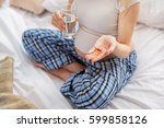 expectant mother taking vitamin ... | Shutterstock . vector #599858126