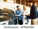 young couple choosing new car...   Shutterstock . vector #599863382