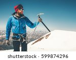 man climber holding ice axe on... | Shutterstock . vector #599874296