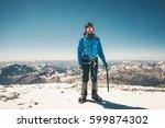 man climber on high mountain... | Shutterstock . vector #599874302