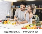 young couple cutting fruit in... | Shutterstock . vector #599904542