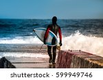 surfer goes into water wearing...   Shutterstock . vector #599949746