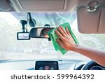 hand cleaning the car interior... | Shutterstock . vector #599964392