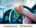 hand cleaning the car interior... | Shutterstock . vector #599964452