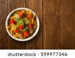 farofa and red peppers.... | Shutterstock . vector #599977346