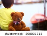 child and a teddy bear | Shutterstock . vector #600031316