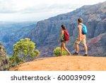 hikers couple hiking in... | Shutterstock . vector #600039092