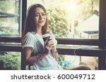 indoor portrait of pretty woman ... | Shutterstock . vector #600049712