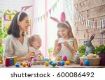 a mother and her daughter are... | Shutterstock . vector #600086492