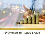 stack of coins on wooden table... | Shutterstock . vector #600117335