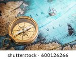 old compass on vintage map.... | Shutterstock . vector #600126266