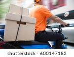 delivery man ride motorcycle... | Shutterstock . vector #600147182