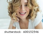 young woman in braces | Shutterstock . vector #600152546