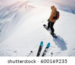Small photo of freeriders on steep slope ready to drop in fresh powder snow