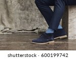 blue shoes on guy in studio ... | Shutterstock . vector #600199742