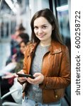 young woman playing with phone... | Shutterstock . vector #600258722
