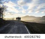 people walking on street sunset ... | Shutterstock . vector #600282782