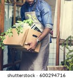 adult man hands carrying paper... | Shutterstock . vector #600294716