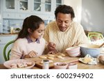 father and daughter decorating... | Shutterstock . vector #600294902